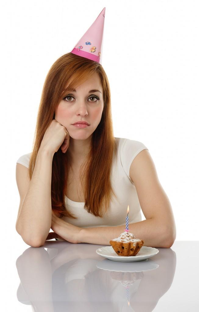 http://www.dreamstime.com/royalty-free-stock-photo-sad-girl-birthday-cake-image22152115
