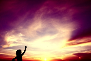 little-boy-raising-his-fist-to-the-sky-at-sunset--1438822-2-m
