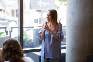 Sarah Boyd at the mic, Simply Stylist Chicago